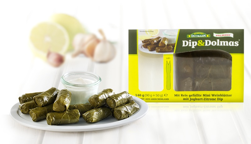 Mini stuffed vine leaves with yoghurt based dip with lemon